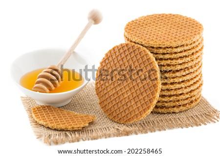 Dutch Waffles with honey isolated on white background - stock photo