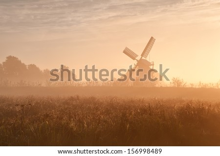 Dutch windmill in fog and morning sunshine, Groningen, Holland