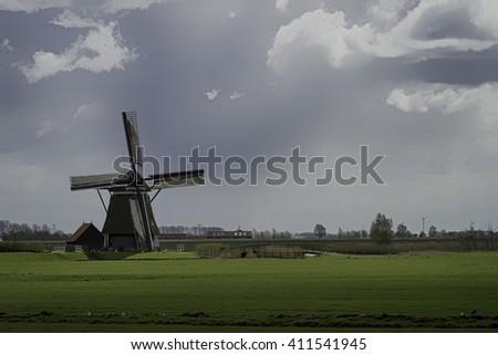 Dutch Windmill in Holland - stock photo