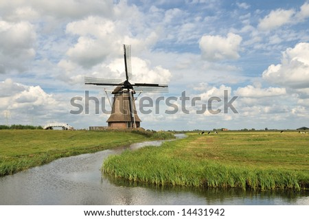 Dutch Windmill , Mill , Agricultural Building with water, pasture and cloudy sky