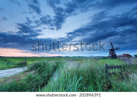 Dutch windmill on meadow at sunrise, Netherlands