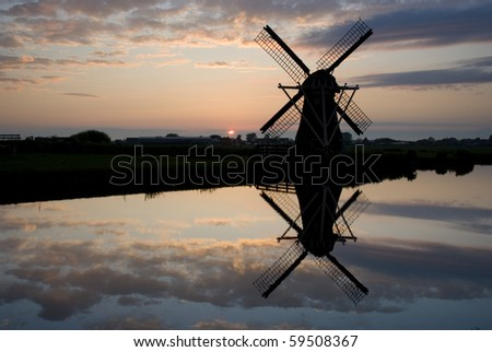 Dutch windmill on sundown - stock photo