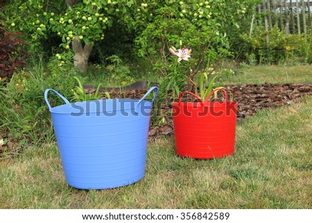 Duty plastic blue red garden pots stock photo 401340886 shutterstock duty plastic blue and red garden pots with handles on the lawn in the summer garden workwithnaturefo