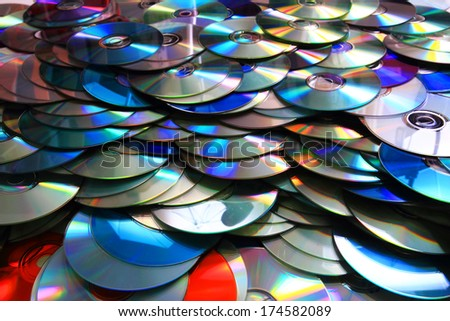 DVD and CD data disc as nice background - stock photo