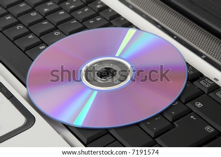 dvd disc placed on laptop computer