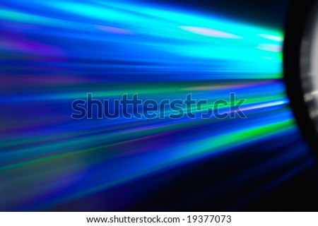 DVD disc with beauteful rays covered them - stock photo