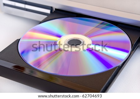 dvd disk insert to dvd player - stock photo