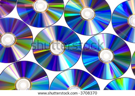 DVD disks on white background, colorful reflections