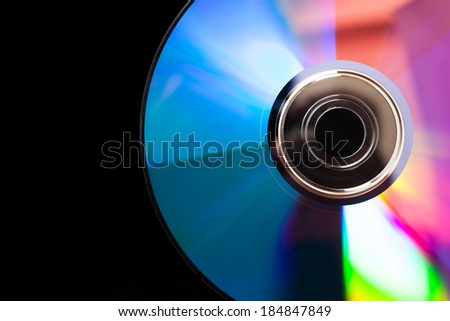 Dvd on dark wooden table. - stock photo