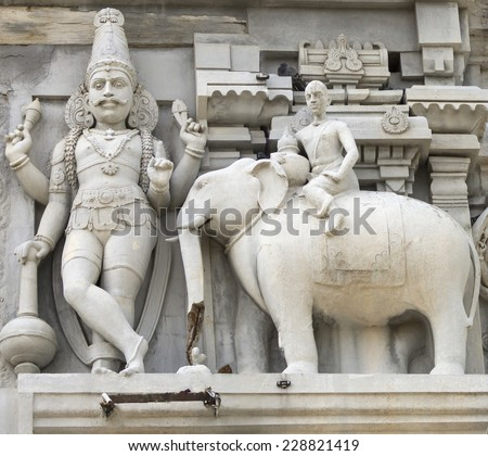 Dwarapalaka, the door keeper, flanked by an elephant. As seen on the eastern Gopuram of the Thiruvannamalai Shiva temple, in India. - stock photo