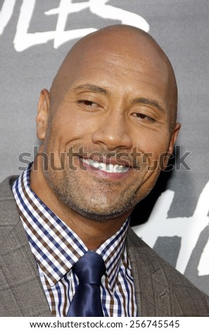 "Dwayne Johnson at the Los Angeles premiere of ""Hercules"" held at the TCL Chinese Theatre in Los Angeles on July 23, 2014 in Los Angeles, California.  - stock photo"