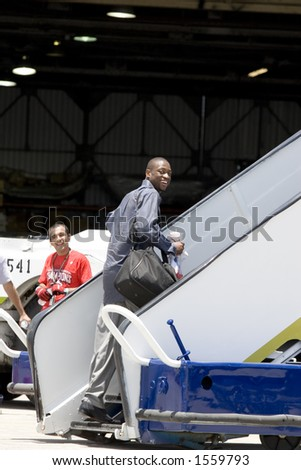 Dwayne Wade getting on the Miami Heat jet. - stock photo