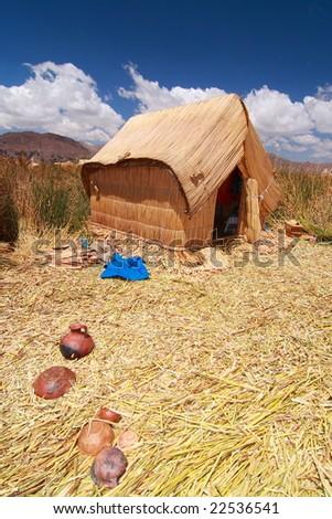 Dwelling on Uros - stock photo