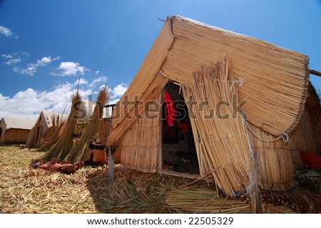 Dwelling on Uros Island - stock photo