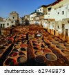 Dye reservoirs in tannery in Fes, Morocco, where the world famous moroccan leather is being made - stock photo