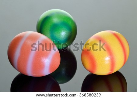 Dyed Easter eggs on a reflective black base