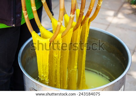 Dyeing silk. Using traditional natural materials - stock photo