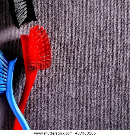 Dynamic black-blue-red scrubbers rustic handmade paper.Quadratic format. - stock photo