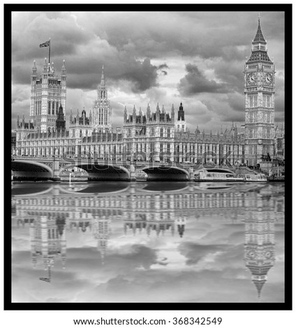 Dynamic black & white image of Big Ben and the houses of parliament in London with a reflection in the River Thames - stock photo