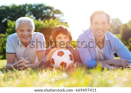 Dynamic charming family resting after a good game