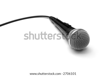 Dynamic microphone and cable isolated on white - stock photo
