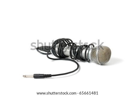 Dynamic microphone. Cord wound on the arm of the microphone. white background - stock photo
