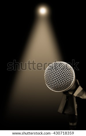 dynamic microphone on stage with concert light for music background - stock photo