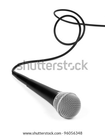dynamic microphone with a curled cable over white. - stock photo