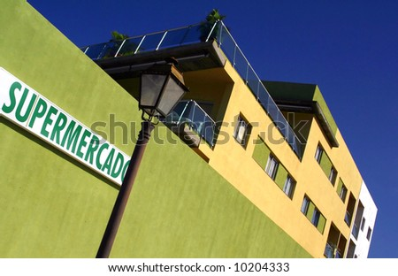 Dynamic perspective of a super market building in spain. - stock photo