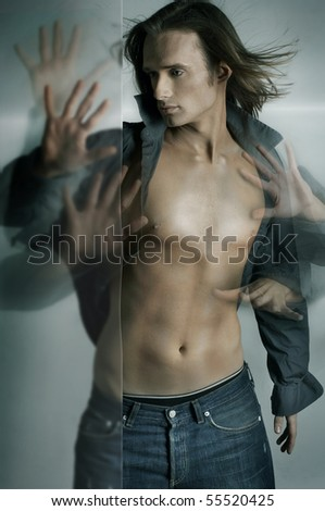 Dynamic photo of a handsome guy with many hands - stock photo