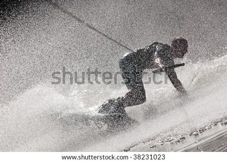 Dynamic Photo Of A Person Drifting While Waterboarding - stock photo