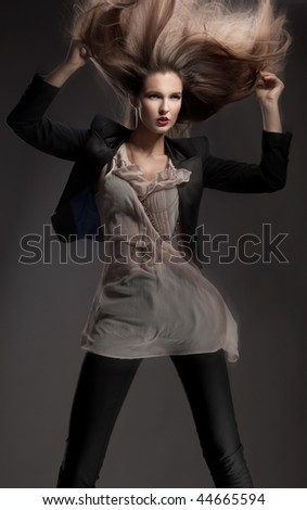 Dynamic photo of a young lady - stock photo