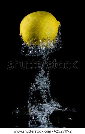 dynamic photo of the lemon in water - stock photo