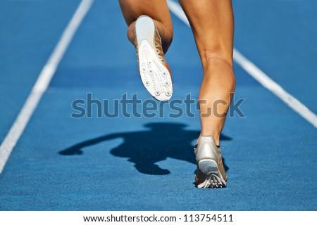 dynamic run of sprinter in a stadium - stock photo
