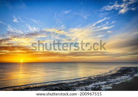 Dynamic sunset at Aldinga Beach, South Australia - stock photo
