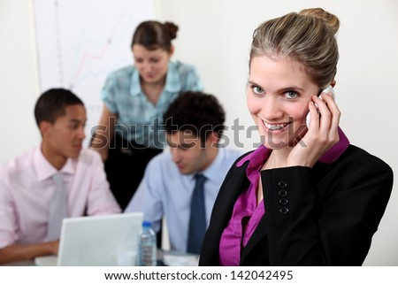 Dynamic team of young businesspeople - stock photo