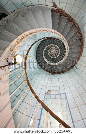 """dynamic view of """"la coubre"""" lighthouse high staircase, france - stock photo"""