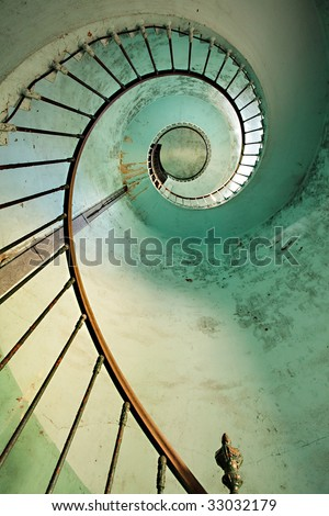 dynamic view on old hourtin lighthouse spiral staircase, france - stock photo