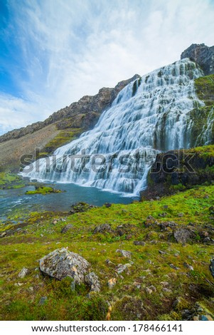 Dynjandi is the most famous and beautiful waterfall of the West Fjords in Iceland. Vertical view - stock photo