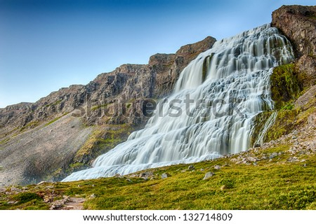 Dynjandi is the most famous waterfall of the West Fjords and one of the most beautiful waterfalls in the Iceland. - stock photo