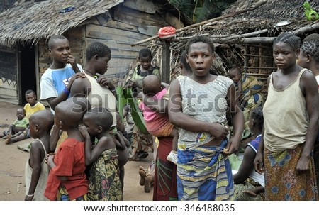DZANGA-SANHA FOREST RESERVE, CENTRAL-AFRICAN REPUBLIC (CAR), AFRICA, 2008 NOVEMBER 2: People from a tribe of Baka pygmies in village of ethnic singing. Traditional dance and music. Nov, 2, 2008 CAR - stock photo