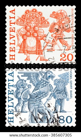 DZERZHINSK, RUSSIA - FEBRUARY 04, 2016: Set of a postage stamp of SWITZERLAND shows Regional Folk Customs, circa 1977 - stock photo
