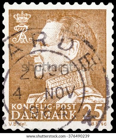 DZERZHINSK, RUSSIA - JANUARY 18, 2016: A postage stamp of DENMARK shows portrait of King Frederick IX (Christian Frederik Franz Michael Carl Valdemar Georg), circa 1961 - stock photo