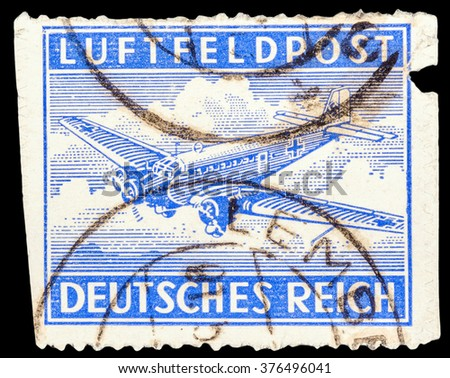 DZERZHINSK, RUSSIA - JANUARY 18, 2016: A postage stamp of GERMANY shows German old airplane. German military air mail service stamp, circa 1942 - stock photo