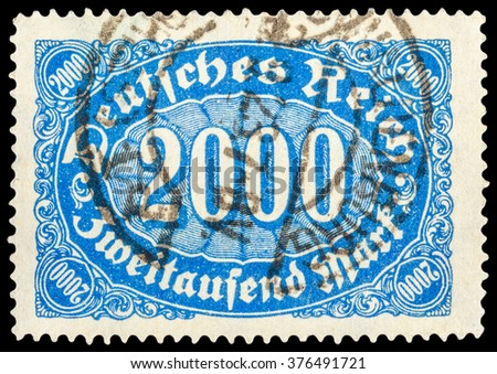 DZERZHINSK, RUSSIA - JANUARY 18, 2016: A postage stamp of GERMANY shows sign of 2000 mark, circa 1923 - stock photo