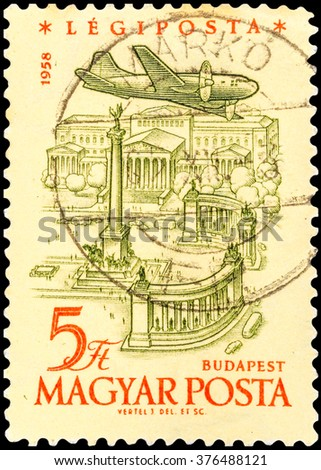 DZERZHINSK, RUSSIA - JANUARY 18, 2016: A postage stamp of HUNGARY shows Plane over Heroes Square in Budapest, circa 1958 - stock photo