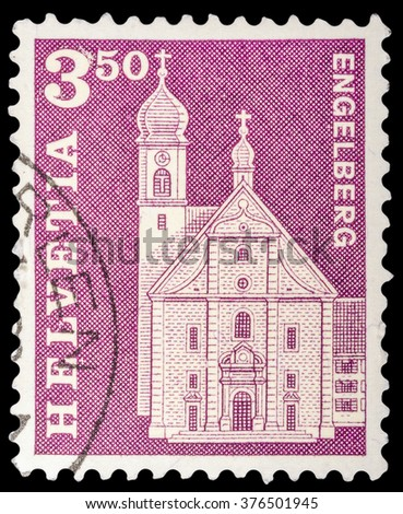 DZERZHINSK, RUSSIA - JANUARY 18, 2016: A postage stamp of SWITZERLAND shows Benedictine Abbey, Engelberg, circa 1964 - stock photo
