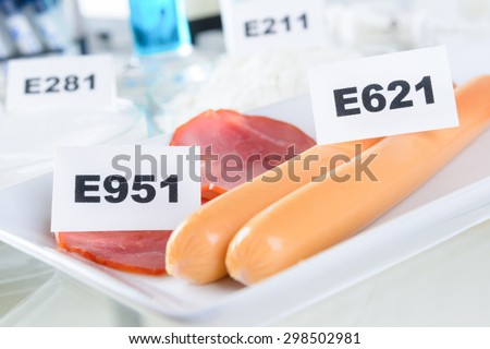 E951 Aspartame ASM. E621 Monosodium glutamate MSG, additives to food. - stock photo