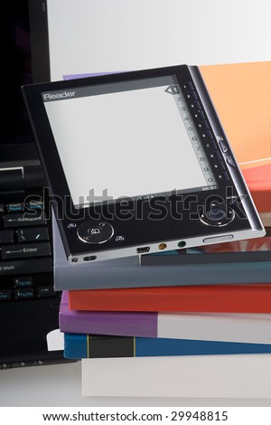 E-book and old books. New technology of reading. - stock photo