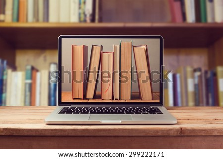 E-book library concept with laptop computer and books - stock photo